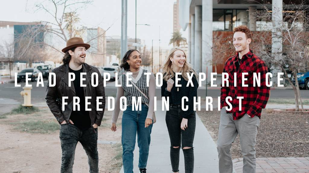 This image is young adults communicating that our goal is to lead people to experience freedom in Christ