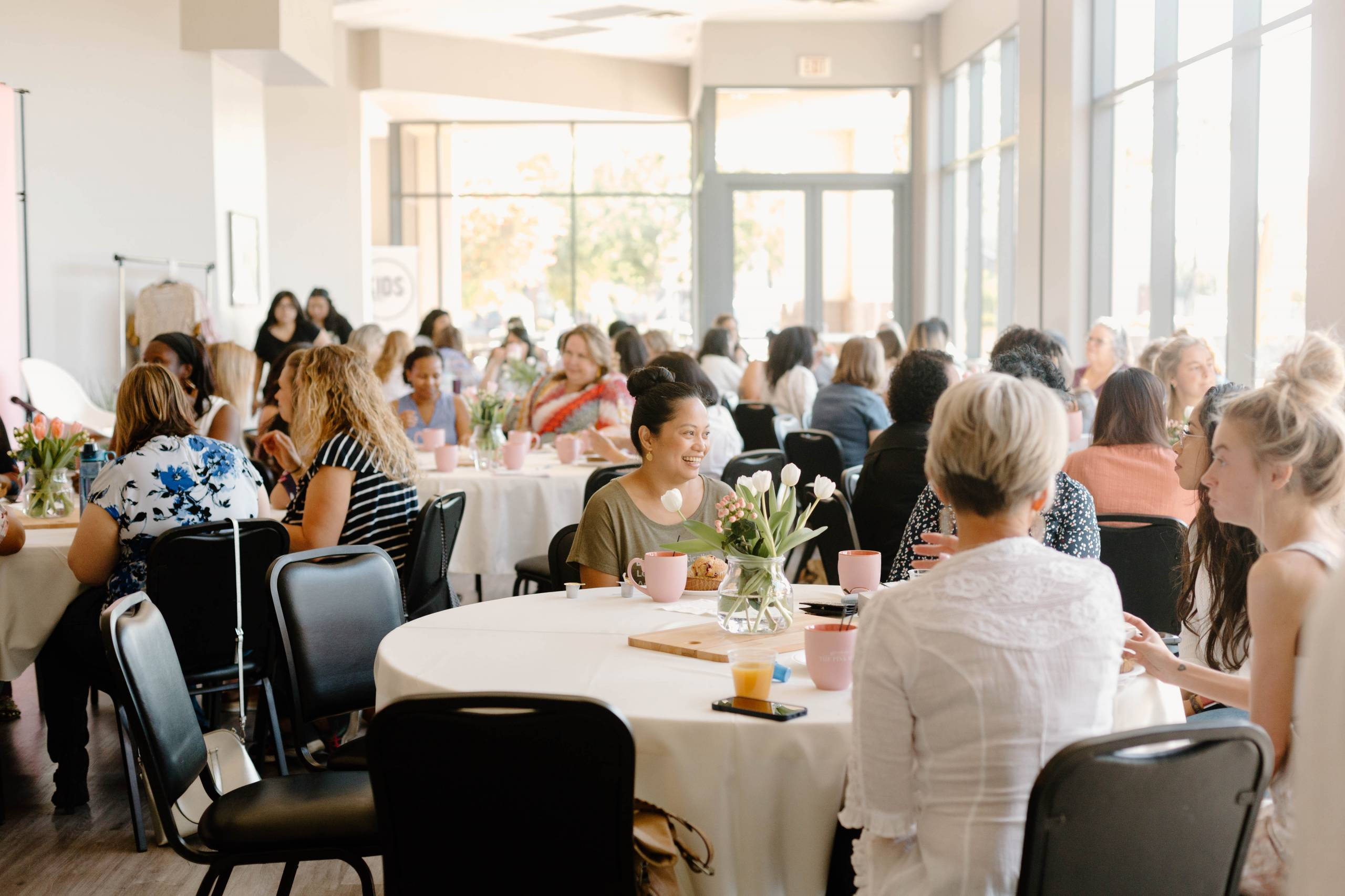 the women's ministry in Chandler Arizona gather at New Heights church around table to connect